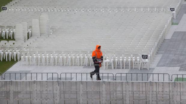 Guns N' Roses prepare for a rainy concert in the capital at Westpac Stadium.