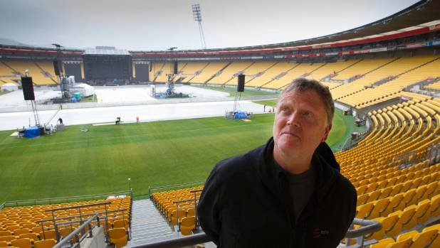 Guns N' Roses' production manager Dale Skjerseth prepares for a wet show in Wellington.