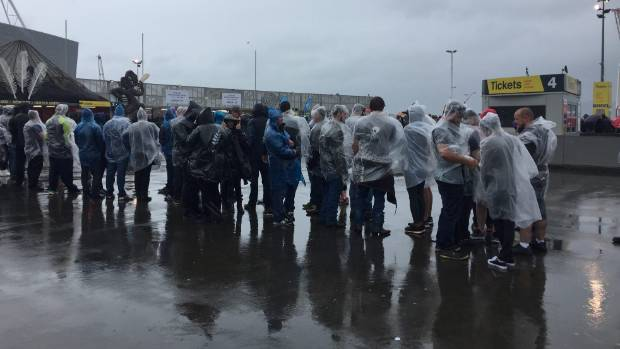 Hundreds of fans forced to wait in the rain outside the Guns N' Roses concert in Wellington on Thursday.