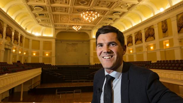 Wellington Mayor Justin Lester inside the Town Hall, behind him is the hole left by the massive 4000-pipe organ that was ...