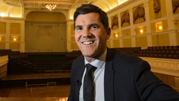 Wellington Mayor Justin Lester in the Wellington Town Hall, behind him the hole left by the massive 4000 pipe organ that ...