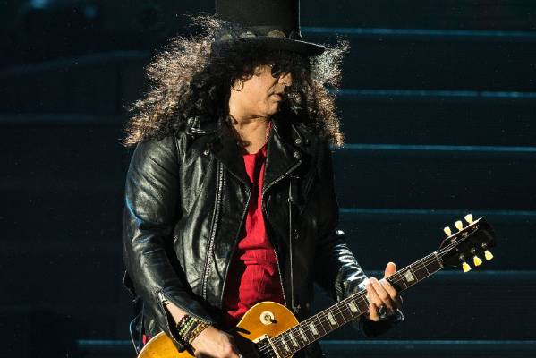 Lead guitarist, Slash, pulls off the perfect windswept look.