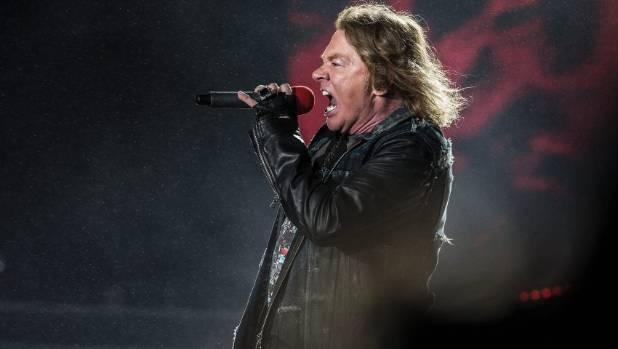 Persistent rain did not put a damper on Guns N' Roses or lead singer Axl Rose.