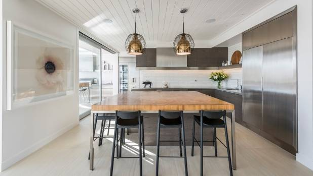 Kitchens are more likely to incorporate organic materials and dark elements, says designer Davinia Sutton.