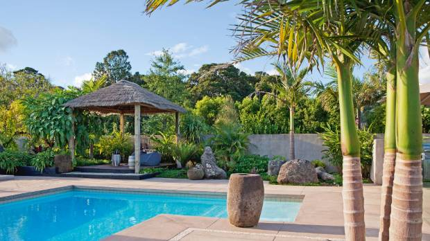 Palms are perfect in this resort-like Whangarei pool area, which shows a strong Balinese influence.