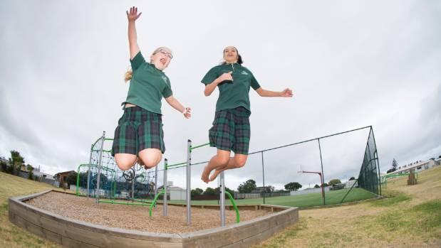 Chelsey Whakaari, 12, (right) and Neve Ganley, 12, (left) love their uniforms.