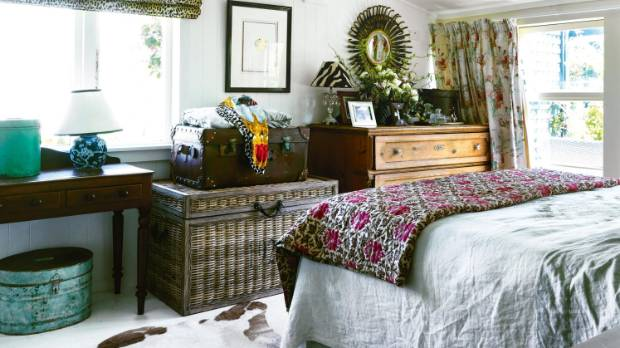 Linen bedding is topped with a heavy, hand-quilted bedspread bought from a Parisian flea market.