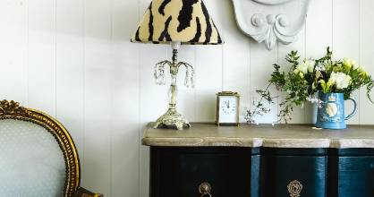 The guest room is also home to a set of drawers from Redcurrent and a lamp topped with a shade that Tina made herself, ...