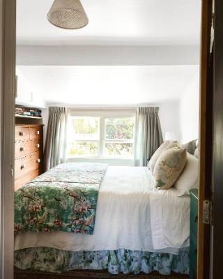 "Guests can stay in what Tina calls the ""grooved-up granny room"", which is large enough to hold a queen bed and kauri dresser."
