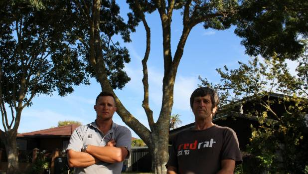 Conifer Grove residents Shaun and Ken McCallum are concerned about the size of the large ash tree outside their home and ...