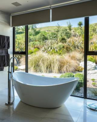 From the master en suite bathroom the view takes in the rich mix of red and silver tussocks alongside a dry creek bed; ...