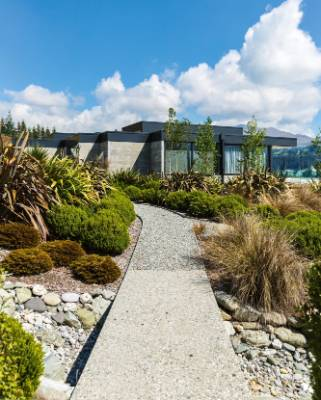 Another award-winning feature of the property, the dry creek bed was created to channel stormwater off the hill and down ...