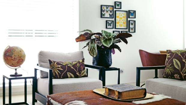 Matching the frames of your art to your furniture furnishes is a sneaky trick to pull a room's look together.