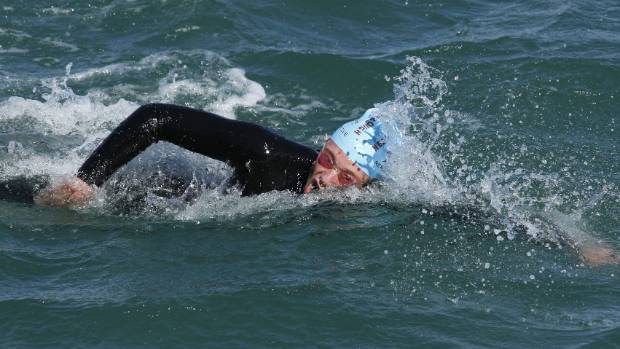 A drop in temperature didn't deter Fraser Neill from winning Thursday's sea swim.