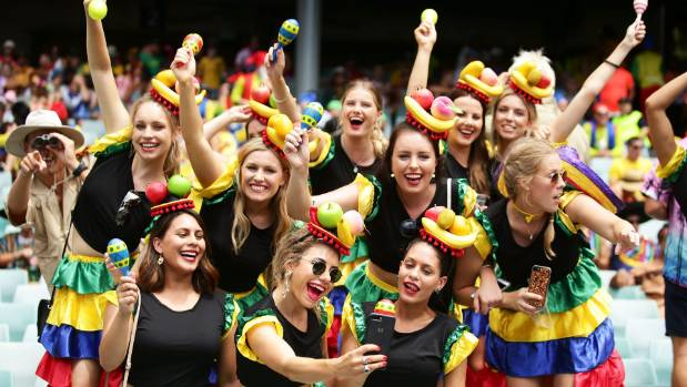 Fans enjoy the atmosphere during the women's semifinal match between Australia and Canada at the Sydney Sevens last weekend.