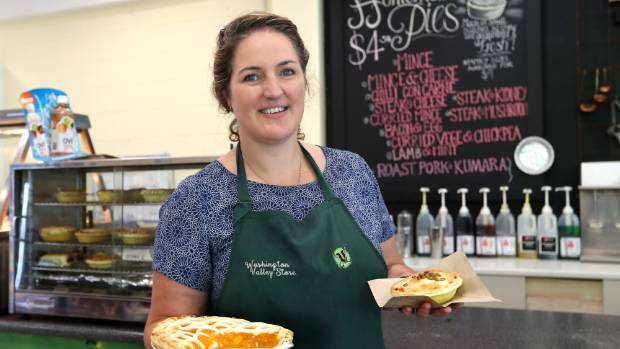 Laura Jacobs shows off an apricot pie and curried vege and chickpea pie.