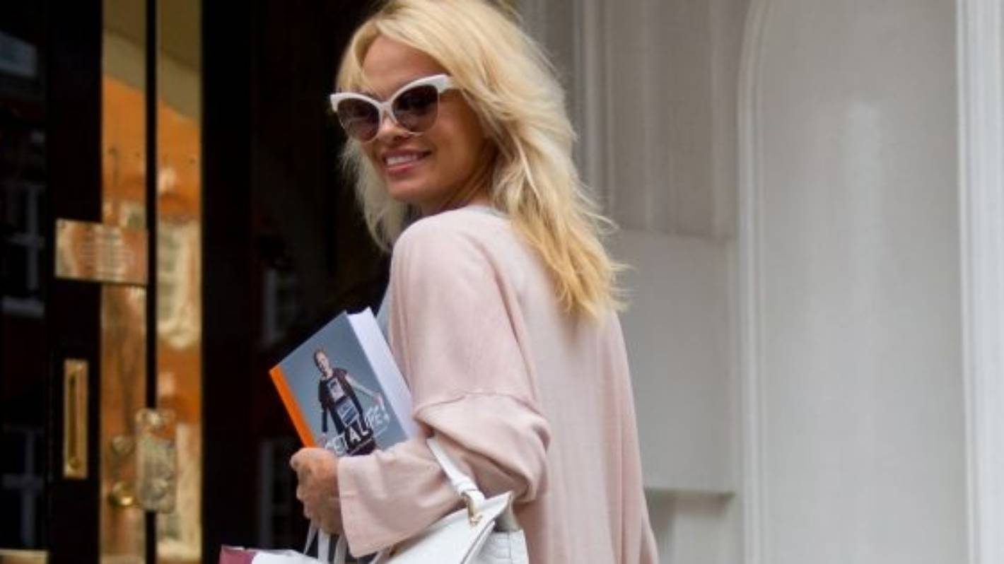 Pamela Anderson may be dating Julian Assange because, of course, it's 2017