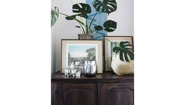 In this photo I love the high contrast between the dark wooden cabinet and the stainless steel GamFratesi vase. The vase ...