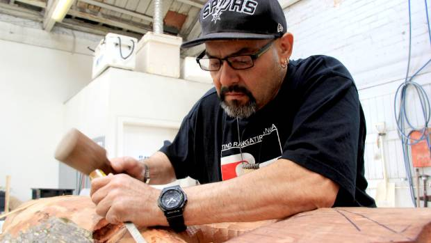 Te Taonga Mauri director and head carver Oti Murray works on his next project: Tanga Roa - Nui - A -Rangi