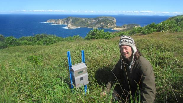 Todd Landers with a Song Meter 3 on Burgess Island.