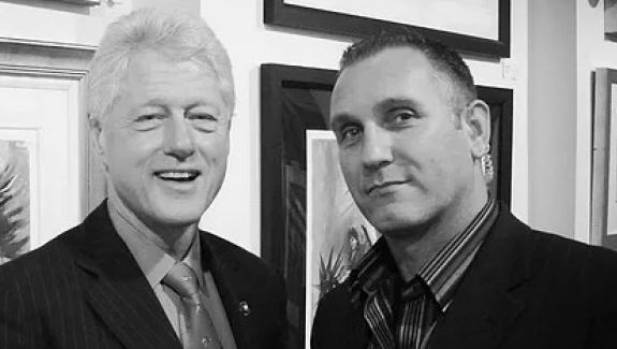 Security consultant Adrian Gard (right), pictured with former US president Bill Clinton.