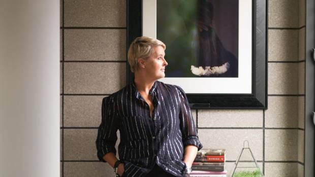 Debra stands in front of another favourite piece, Female Huia by Fiona Pardington.