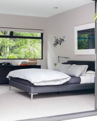 Above the bed in the master bedroom is Eclipse, a photograph by Australian artist Martine Emdur.