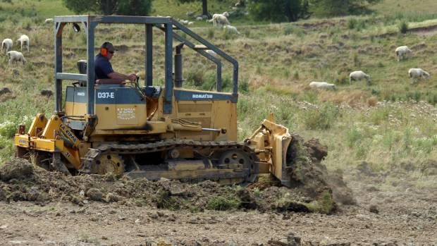 Wade Stoddart spends every free moment on the dozer fixing the aftermath of a huge earthflow on Arataura Station.