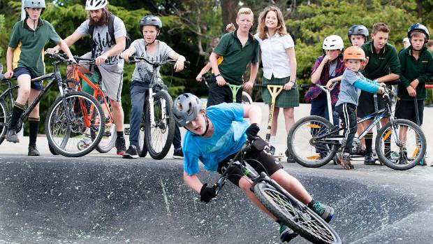 Josh Pearson is the centre of attention as he gives Te Anau's new pump track a speed test.