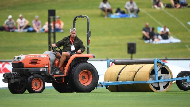 Head groundsman Phil Stoyanoff works on drying the out field on the day the ODI was abandoned.
