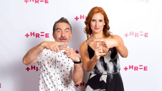 Dai Henwood and Samantha Hayes helpfully demonstrate two out of the five symbols in TV3's - now known as Three - new logo.
