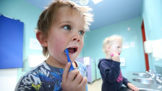 Harry Holland, 4, left, and Kayla Flood, 3, shine their pearly whites at Seymour Kindergarten.