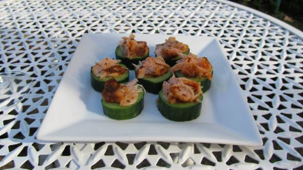 Thick slices of cucumber topped with smoked salmon make a great snack.
