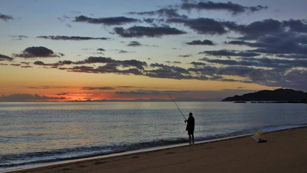 JANUARY 9: Sunrise at Totaranui Beach in the Abel Tasman National Park, New Zealand, the morning after the big storm.
