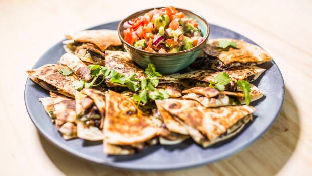 These mushroom & black bean quesadillas make for a tasty meat-free snack or light dinner.