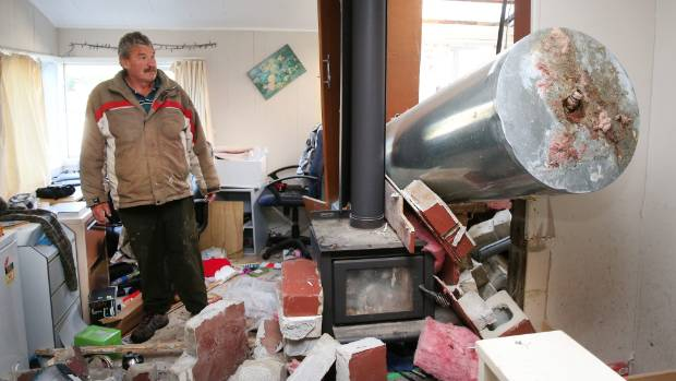 Ward resident Bryan Phipps surveys the damage to his home immediately following the November earthquake.