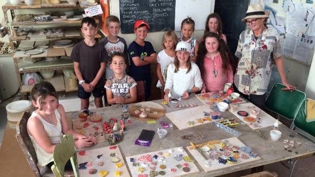 Showing off their creations are, from left,  Grace Boyd,  Jacob Gray, Theo Gray, Luca Devoti, Sid, Anna and Sadie ...