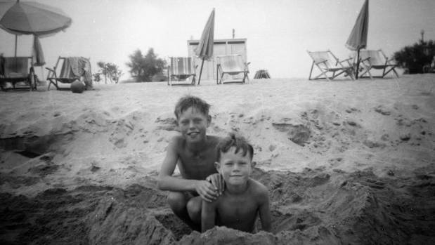 Mick Jagger (left) aged 8, on a family holiday with his younger brother Chris (right) in 1951.