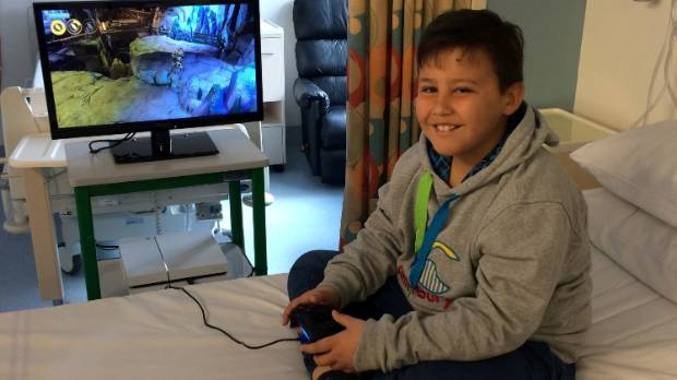 Angus building his mansion on Minecraft in the oncology ward at Wellington Hospital.