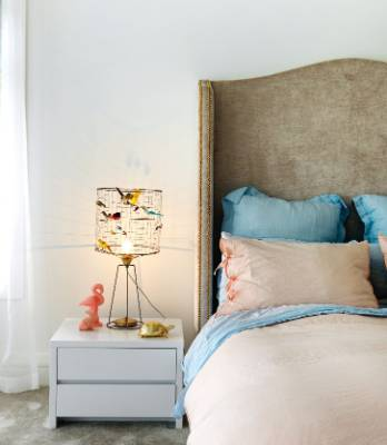 A girl's bedroom in Auckland with a Voliere Haute table lamp from ECC and the studded headboard was custom designed.