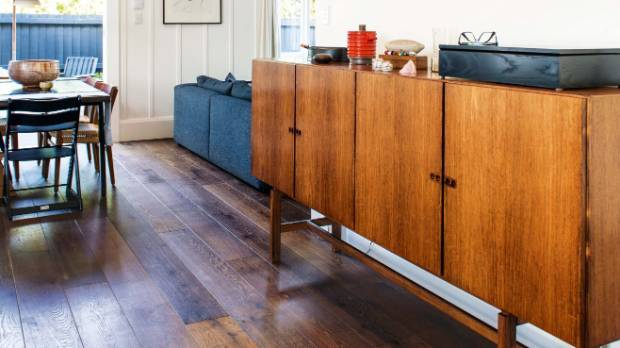 This mid-century palisander sideboard by Ib Kofod-Larsen works well in the space between the dining room and kitchen.