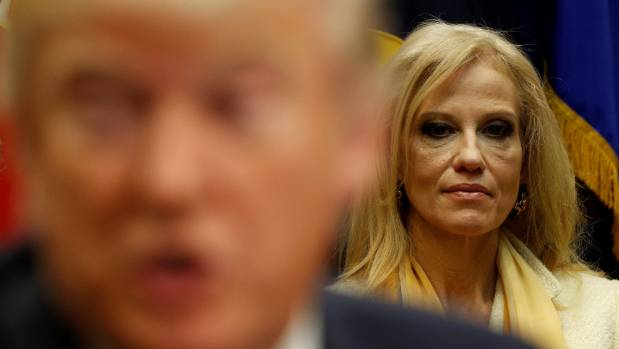 White House advisor Kellyanne Conway listens as US President Donald Trump meets with county sheriffs at the White House.