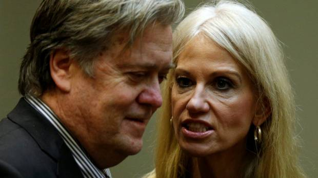 US President Donald Trump's chief strategist Steve Bannon (left) and senior aide Kellyanne Conway speak at meeting ...
