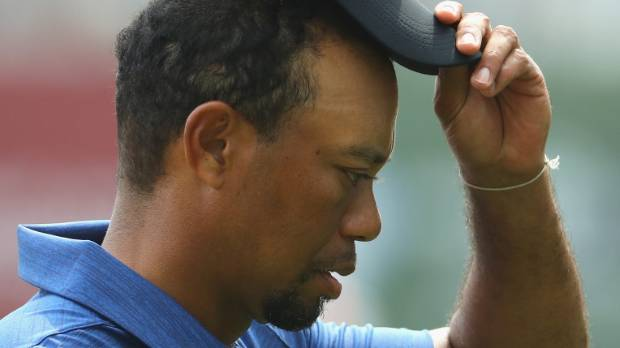 Injured Woods withdraws from two tournaments