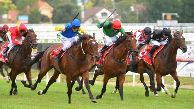 Black Heart Bart (left) claims the lead from Turn Me Loose and goes on to win the Group I C F Orr Stakes at Caulfield.