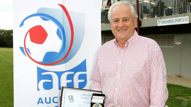 Tom Street from Eastern Suburbs Football Club receives a long service award from the Auckland Football Federation.