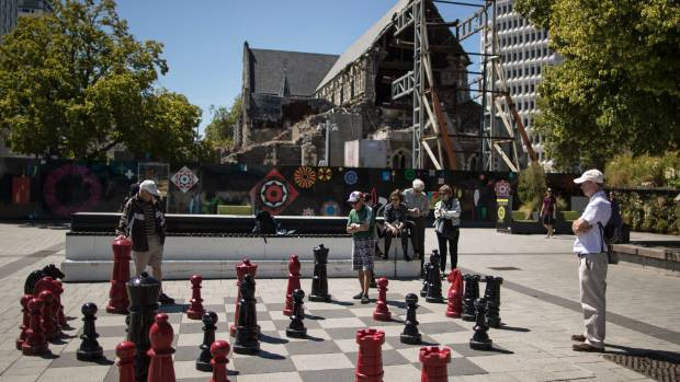 People play chess in front of the earthquake-damaged Christ Church Cathedral in January.
