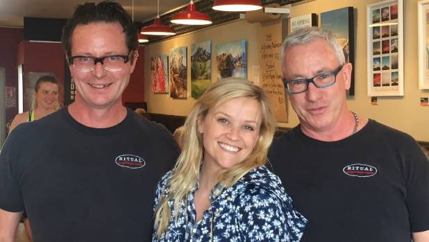 Reece Witherspoon with Paul Tregea, left, and Chris Hadfield, co owners of Ritual Cafe in Wanaka. She visited about noon ...