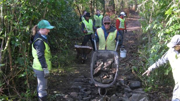 Volunteers work on the Kawatiri River Trail.