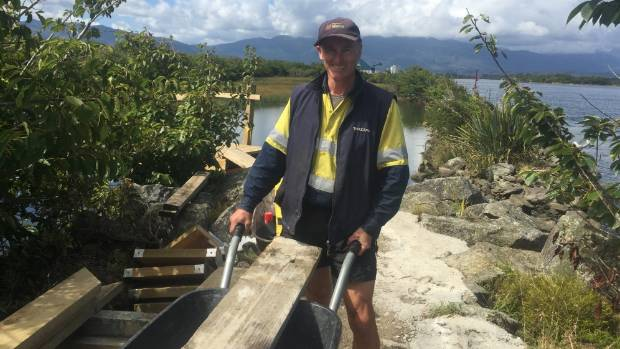Volunteer Paul Comeskey building the Kawatiri River Trail.